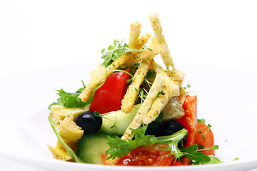 Fresh salad from seasonal vegetables with croutons