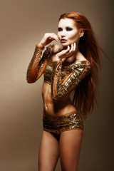 Radiance. Glitter. Glamorous Asian Woman in Golden Clubwear