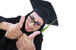 Asian graduate give thumbs up - isolated