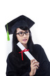Attractive woman in graduation gown - isolated