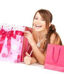girl with colorful gift bags