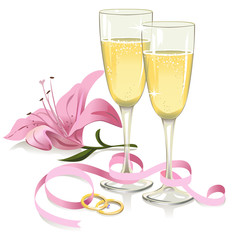 wedding glasses with rings, ribbon and lily