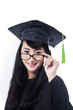Happy woman in graduation gown - isolated