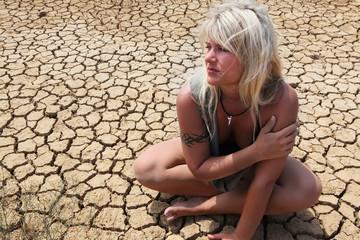 Female sitting on the desert floor