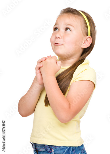 Cute little girl is praying