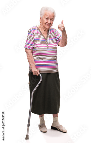 Old woman with a cane showing ok sign  on a white background