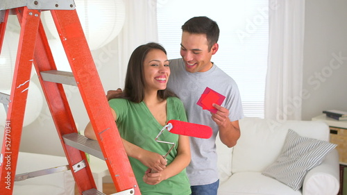 Happy Mexican couple doing home improvements