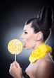 Portrait of beautiful woman with beauty hair licking lollipop