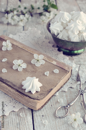 Vintage style decoration with meringue kisses and cherry flowers