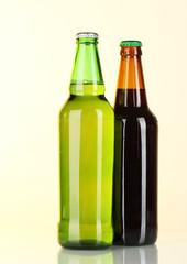 Bottles of beer on light background