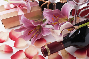 Wine,gift and lilies