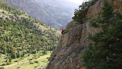 female climber climbing mountain