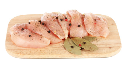 Chicken meat on board isolated on white
