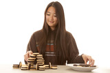 woman stacking cookies smile