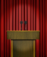 Podium and microphones over red curtains