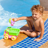 little boy playing near the pool