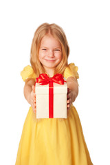Little girl giving a gift. Holiday concept.