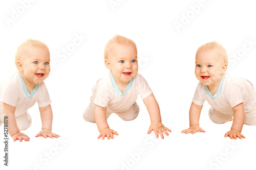 Three happy babies crawling and laughing.