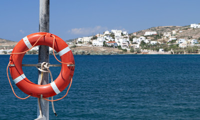 Old life buoy on a Greek island at the Aegean sea