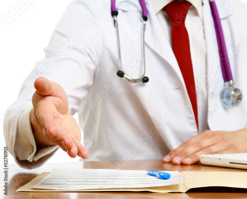 Unknown male doctor with stethoscope sitting at desk isolated