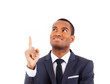 Portrait of happy African American businessman pointing upwards