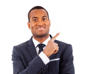 Portrait of happy African American businessman pointing at copy