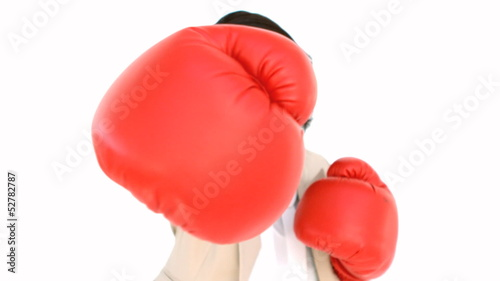 Businesswoman boxing at the camera