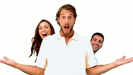 Friends hiding behind a man on white background