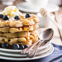Waffles with blueberries and ice cream