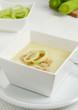 Fresh hot leek soup in white bowl