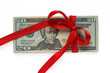 dollars tied with red ribbon isolated on white
