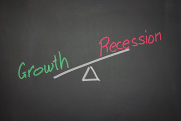 A drawing depicting the balance of growth and recession on a bla