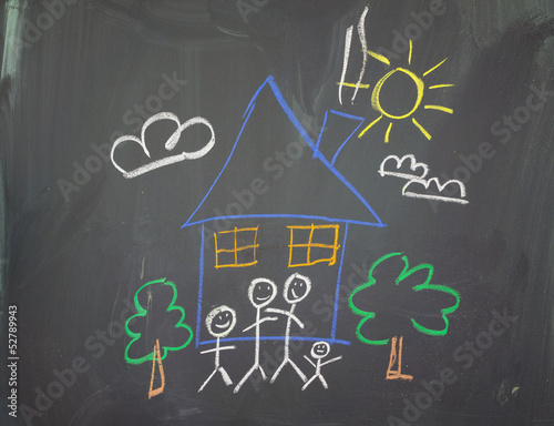 A childs drawing of a happy family at home.