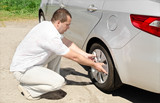 Car wheel defect man change puncture poster