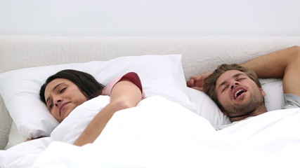 Woman annoyed by her husbands snoring