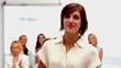Buisnesswomen applauding colleague