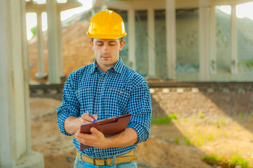 a young worker with clipboard