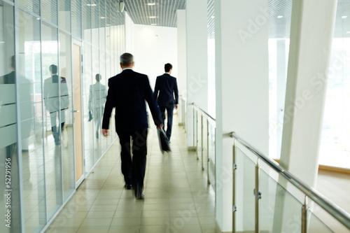 Walking along corridor