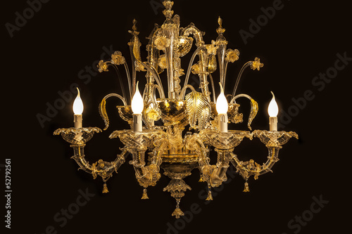 Beautiful chandelier(Murano Italy) isolated on black background.