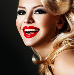 beautiful blonde  woman with bright red lipstick