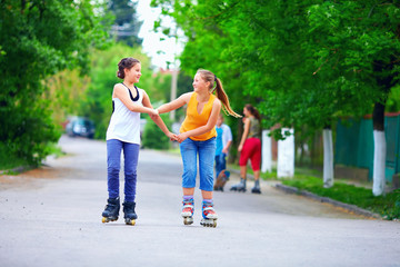 teenage roller girls skating on the street