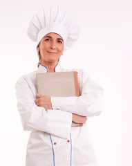 Female cook with book