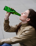woman drinking beer from the bottle