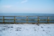 Seebrücke im Winter - Blick zum Horizont