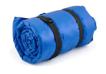 Rolled blue inflatable camping bed