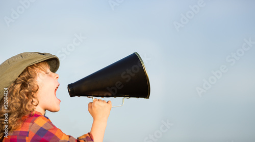 Leinwanddruck Bild Kid shouting through megaphone