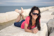 Beautiful Woman with Sunglasses at the Beach