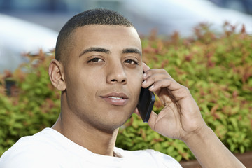 Handsome young man talking on smartphone