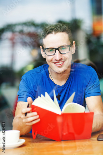 handsome man thinking in cafe, office or home