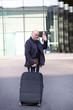 Elderly man waving goodbye